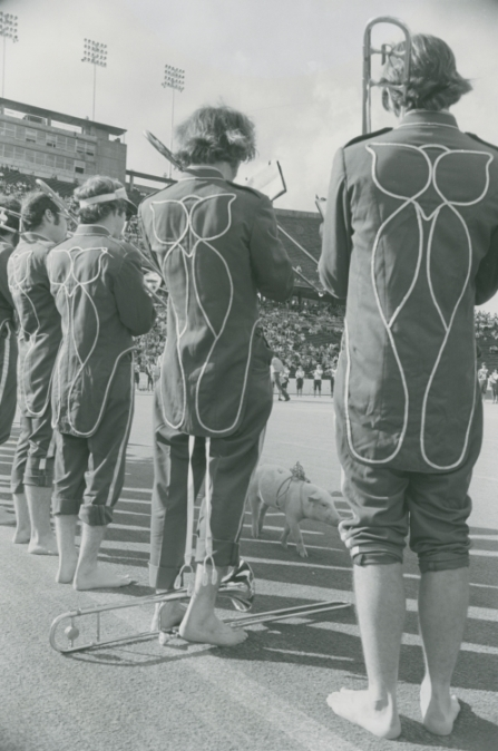 Rice MOB members with owl designs on their uniform jackets and bare feet, at Rice vs. Arkansas game, 1975