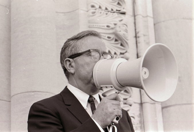 Dr. Masterson speaking with bullhorn during the Masterson presidency controversy
