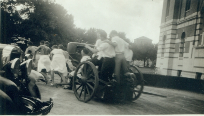 May Fite in action in front of Administration Building, 1933