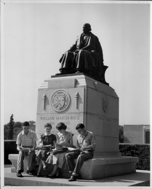 William Marsh Rice statue with four students, seated, 1955