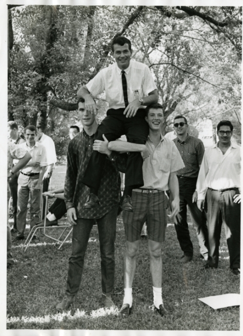 Bill Lacy, of the Rice School of Architecture, held aloft by students, 1964