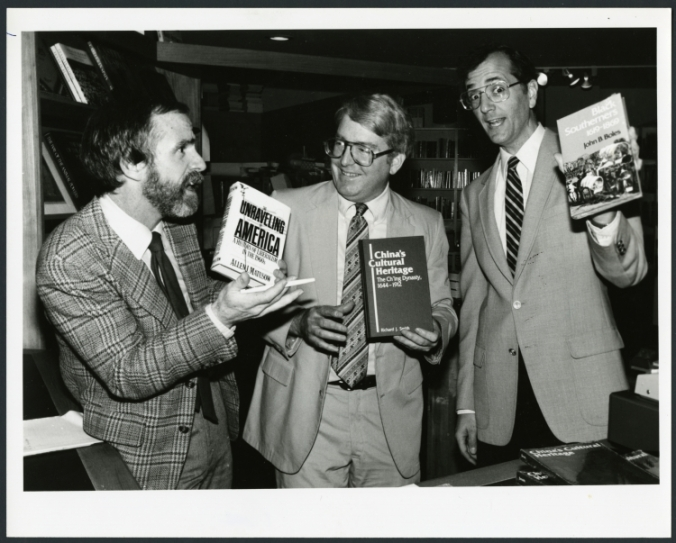 Drs. Richard Smith, John Boles, and Allen Matusow pose with each other's publications, 1984