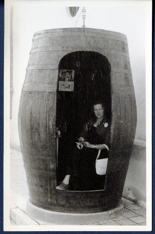 Juliette Huxley in barrel, Gonzalez Byass bodega, Spain, May 1957