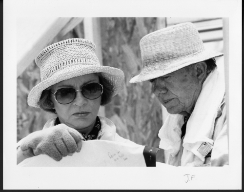 Rosalynn Carter with President Jimmy Carter looking at plans for a Habitat for Humanity house. They worked on the project with Rice University and its employees. June 1998. Photograph by Jeff Fitlow.