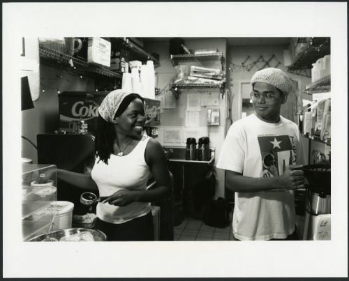 Tumi Johnson and Mondro Barman working at Coffeehouse, December 1998. Photograph by Jeff Fitlow.
