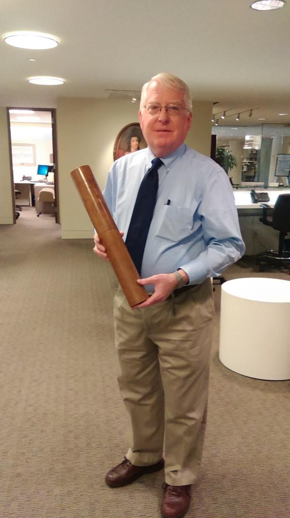 Dr. John Boles holding his favorite wooden tube