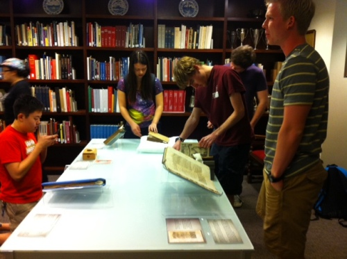 Students examining History of Science collection