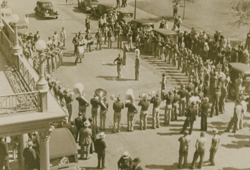 Rice Institute Band downtown outside Rice Hotel, 1930s