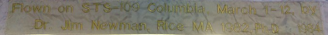 Text reads: Flown on STS-109 Columbia, March 1-12, by Dr. Jim Newman, Rice MA 1982, Ph.D 1984
