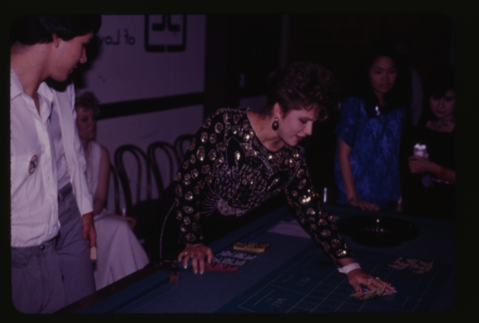 Student playing the tables at Lovett College's Casino Party, 1987