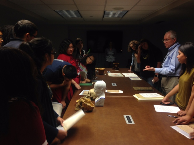 Students examining phrenological materials
