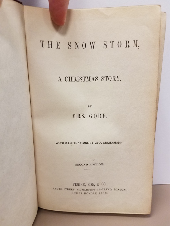 "Text reading: ""The Snow Storm, A Christmas Story. by Mrs. Gore with illustrations by Geo. Cruikshank"