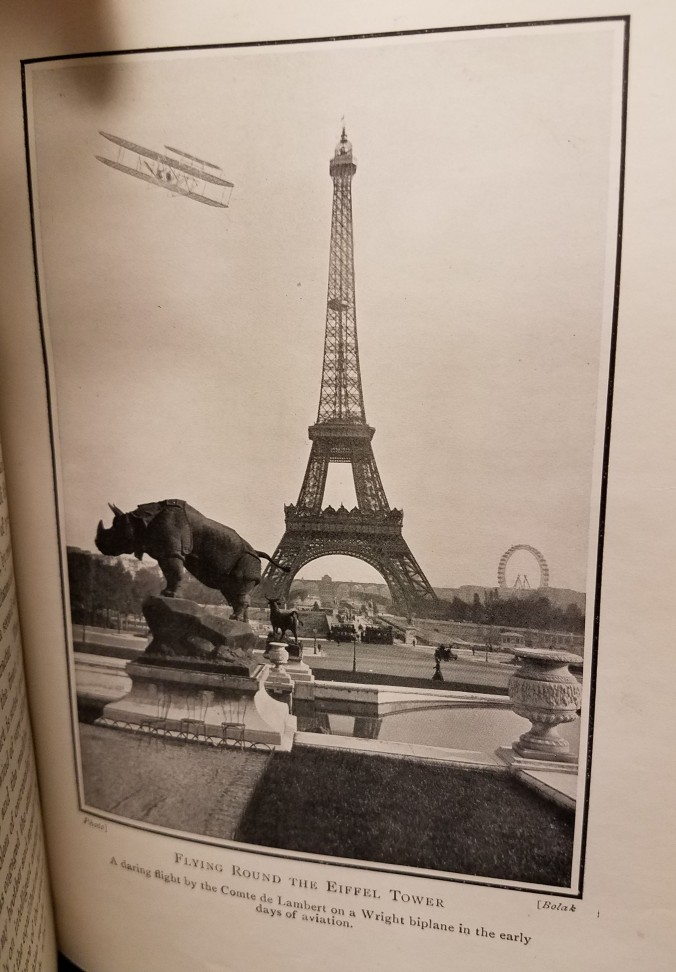 """Flying Round the Eiffel Tower: A daring flight by the Comte de Lambert on a Wright biplane in the early days of aviation."" One image."