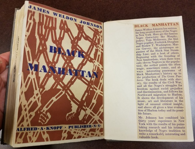 Original cover pasted into the back of the book.