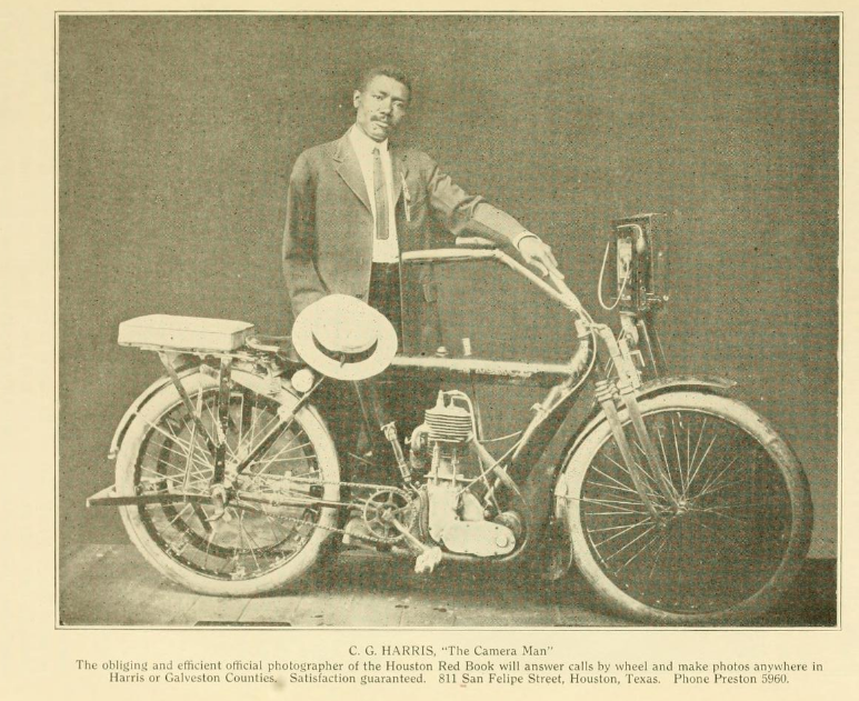 """Image of C.G. Harris posing with bike. """"C.G. Harris, 'The Camera Man' The obliging and efficient official photographer of the Houston Red Book will answer calls by wheel and make photos anywhere in Harris or Galveston Counties. Satisfaction guaranteed. 811 San Felipe Street, Houston, Texas. Phone Preston 5960."""""""