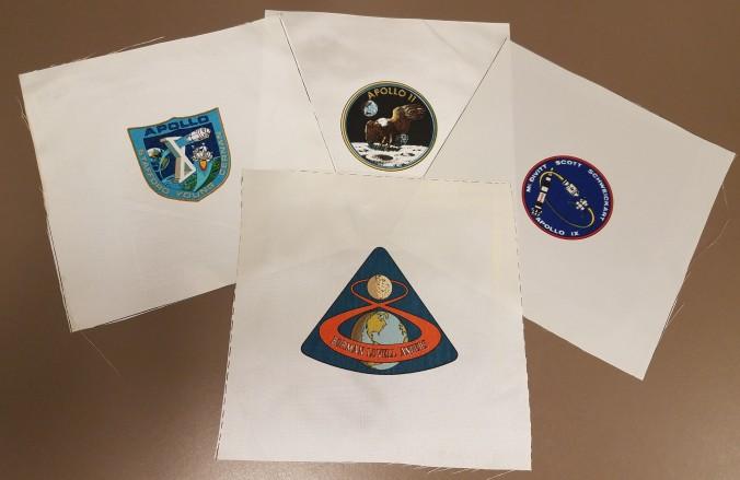 Four silkscreened emblems
