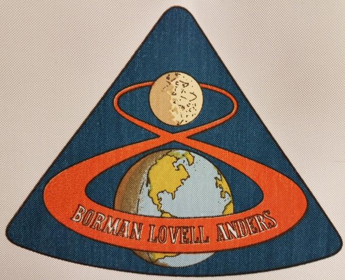 "Silkscreened emblem reading ""Borman Lovell Anders"""