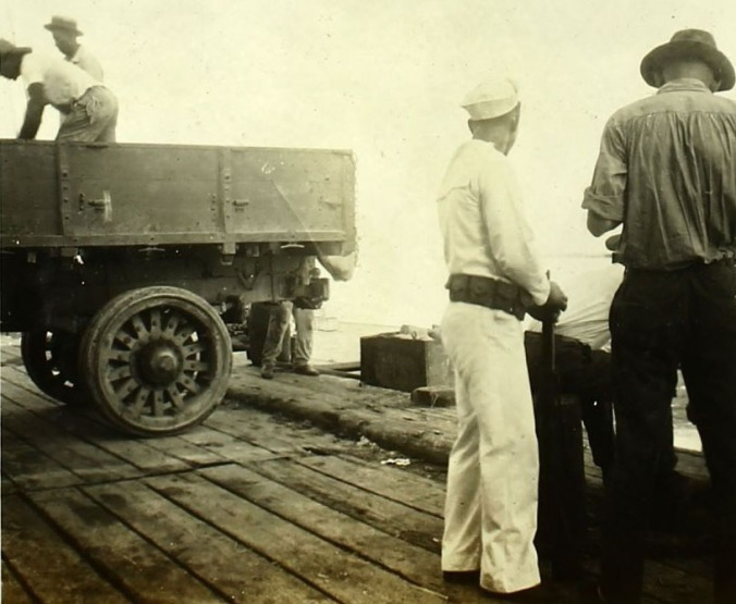 Men unload truck.