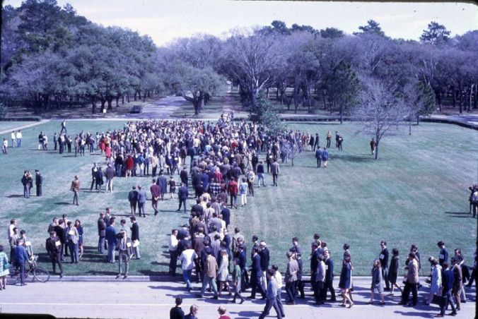 Color slide of crowd protesting the Masterson appointment arriving in front of Lovett Hall on Saturday, February 22, 1969