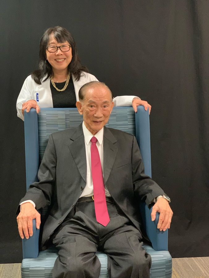 Dr. George C.Y. Chiou seated with daughter, Dr. Linda Epner