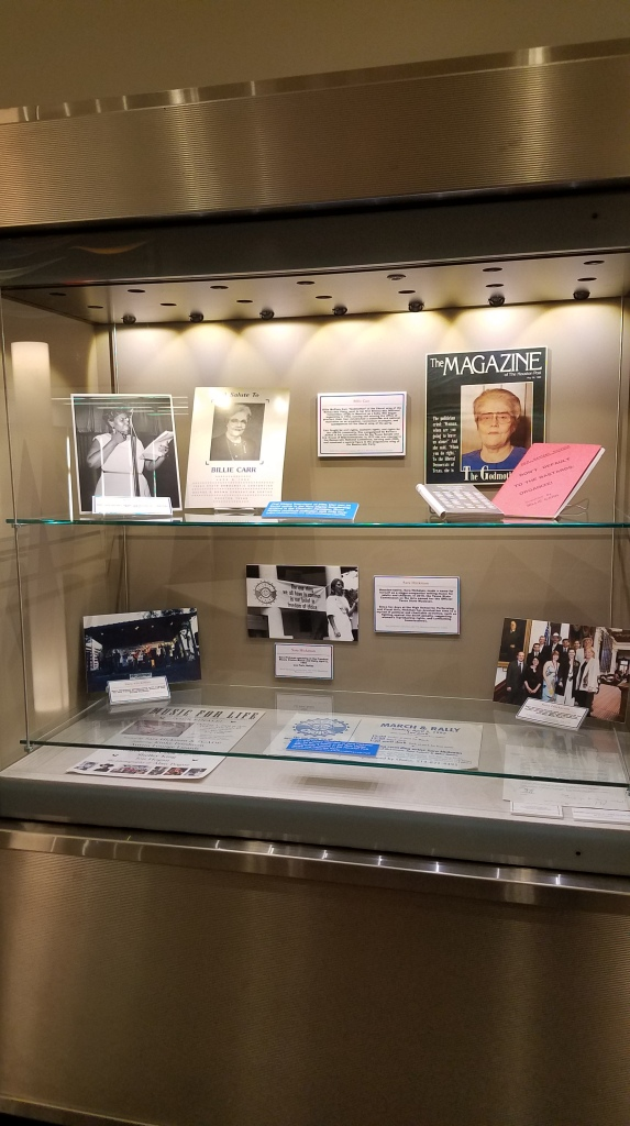 Exhibit case focusing on Billie Carr and Sara Hickman