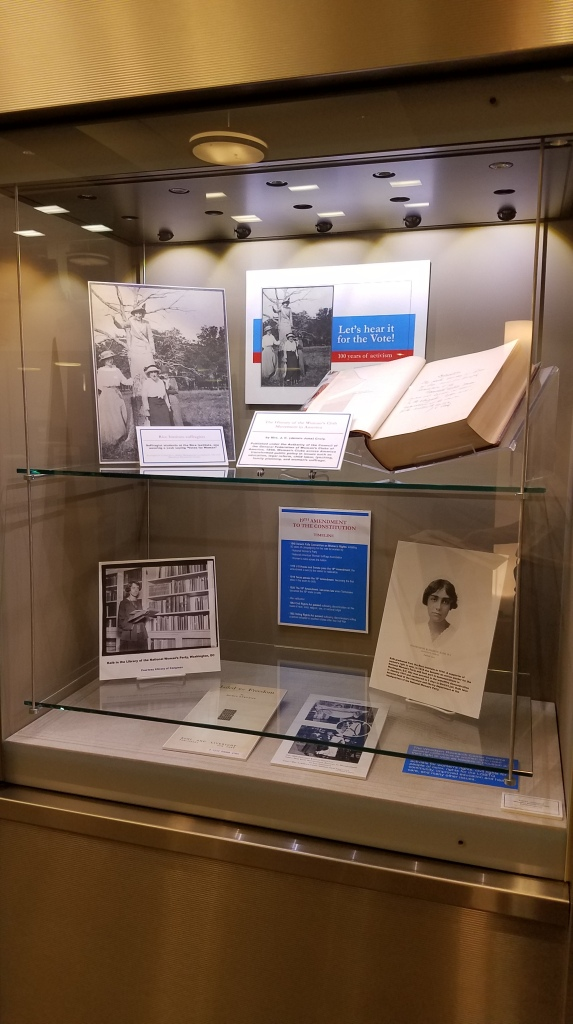 Items from exhibit case showcasing women's history at Rice.