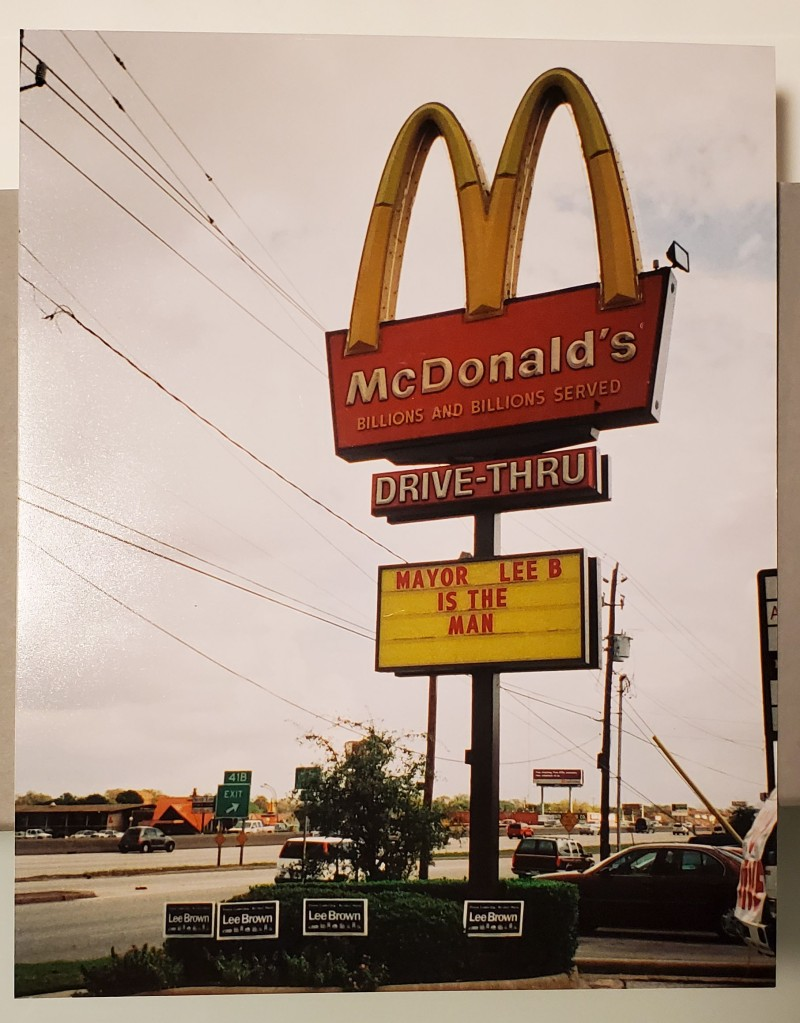 Text reads on McDonald's sign: Mayor Lee B is the man
