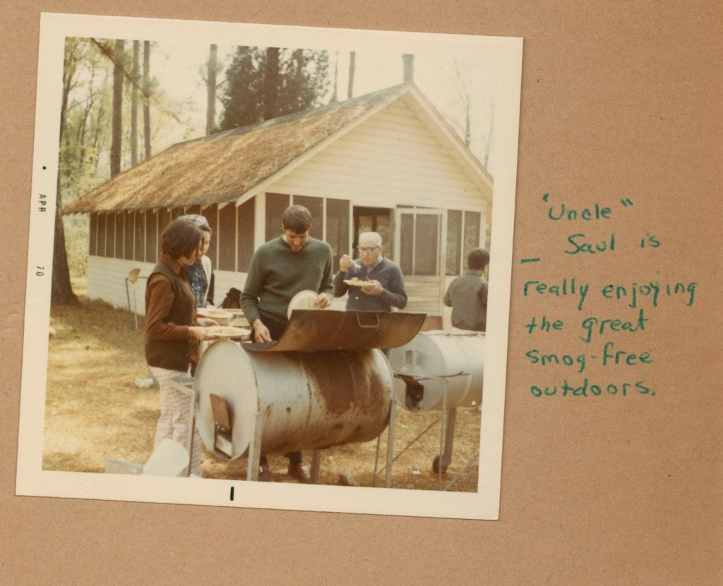 """Image of people at barbecue. Text reads: """"'Uncle' Saul is really enjoying the great smog-free outdoors."""""""