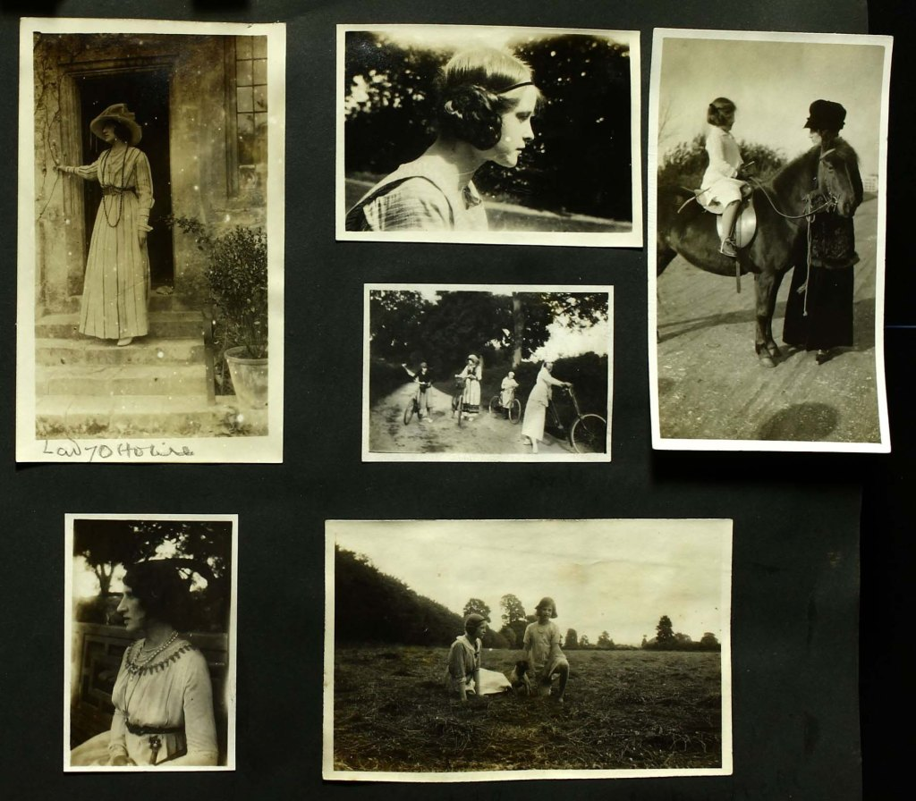 5 photographs pasted into a scrapbook with one loose one.