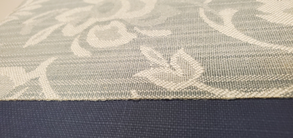 Image of applied lace on book cover.
